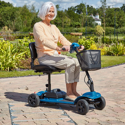 Woman driving mobility scooter